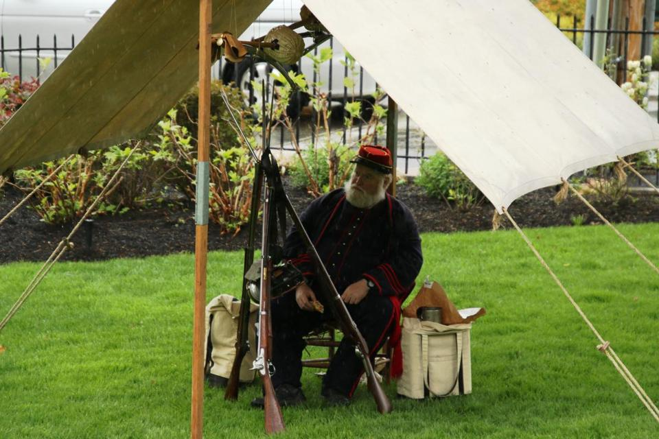 John O'Brien of Woburn, a member of the Salem Zouaves Civil War reenactiment group, takes a break during a rainy Watch City Steampunk Festival May 12 in Waltham. (George Weinstein photo)