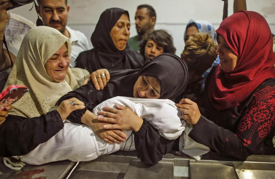 A mother held her 8-months baby, Leila al-Ghandour, at the morgue of al-Shifa hospital in Gaza Cityon Tuesday.