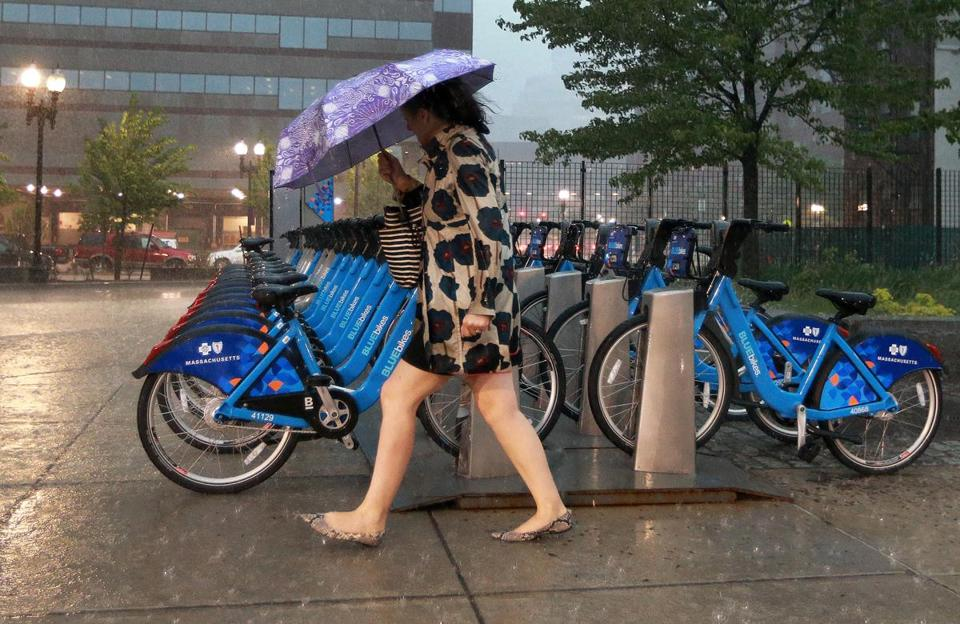 It was not an afternoon for riding a bike, and it wasn't much better for walking outside of TD Garden as heavy rain fell.