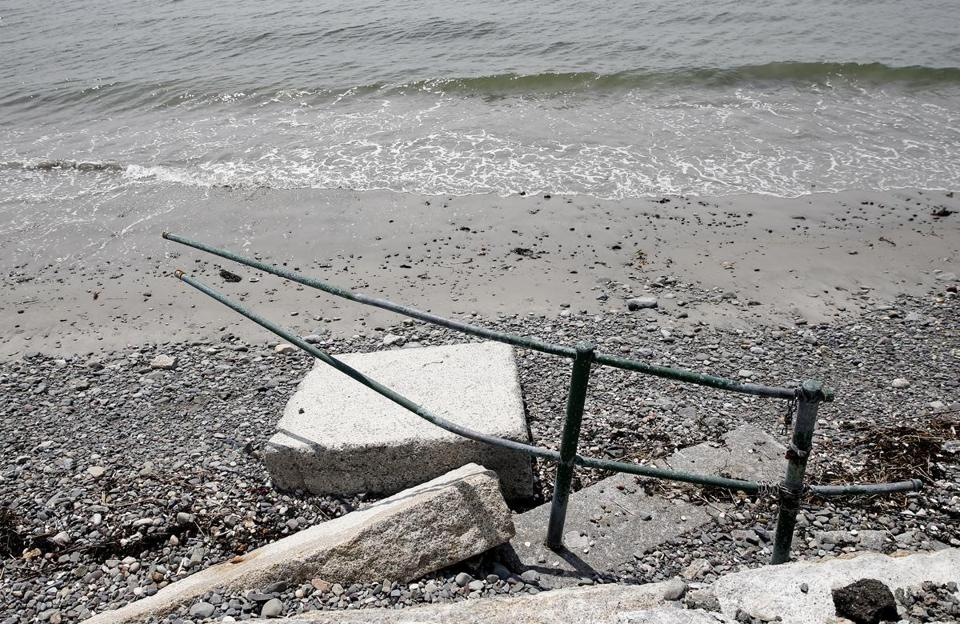 A section of railing along Nahant's Tudor Beach was damaged by the winter storms.