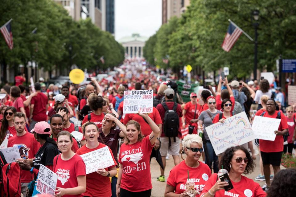 Mandatory Credit: Photo by CAITLIN PENNA/EPA-EFE/REX/Shutterstock (9677774b) Protestors gather in the streets during a North Carolina public school teacher march and rally in Raleigh, North Carolina, USA, 16 May 2018. The teachers are asking for high salaries and more school funding from the North Carolina legislature. North Carolina public school teacher march in Raleigh, North Carolina, USA - 16 May 2018