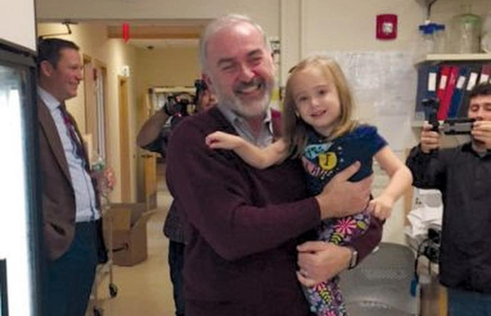 16stoke -- Adrian Krainer, a molecular genetics professor at Cold Spring Harbor Laboratory, with a 3 1/2-year-old Emma Larson from Long Island who had been dosed with Spinraza during clinical trials and visited him in late 2015. She has improved dramatically. (Cold Spring Harbor Laboratory)