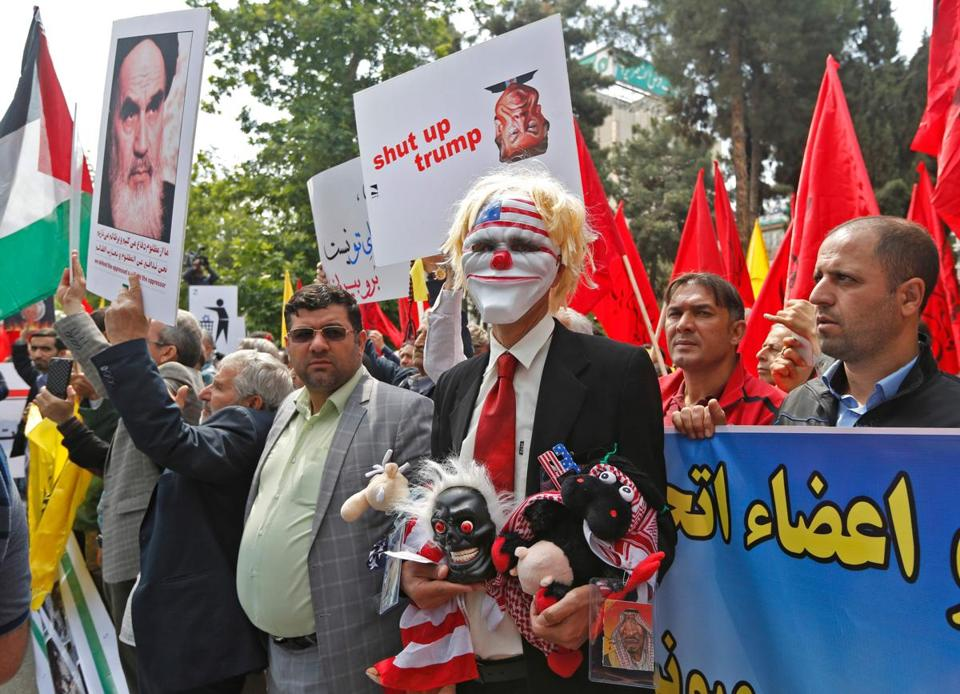 "Iranians take part in an anti-US demonstration inside the former US embassy headquarters in the capital Tehran on May 16, 2018. Iran said today that new US sanctions on its central bank governor would only make Iranians ""more determined, patient and resistant than ever"". / AFP PHOTO / ATTA KENAREATTA KENARE/AFP/Getty Images"