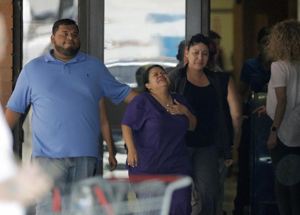 People react as they leave the family unification center at the Alamo Gym, following a shooting at Santa Fe High School Friday, May 18, 2018, in Santa Fe, Texas. (AP Photo/David J. Phillip)