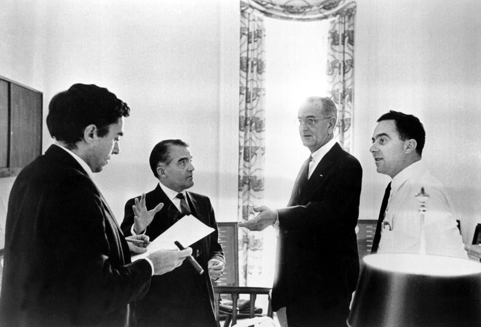 President Lyndon B. Johnson consulted with assistants while drafting the State of the Union address at the White House in 1966. From left are Richard Goodwin, Jack Valenti, President Johnson, and Joseph A. Califano Jr.