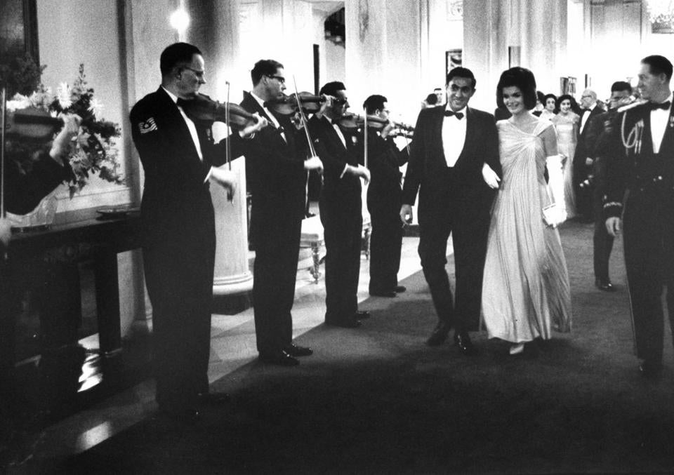 Jacqueline Kennedy walked with Richard Goodwin at a White House party for Nobel Prize winners.
