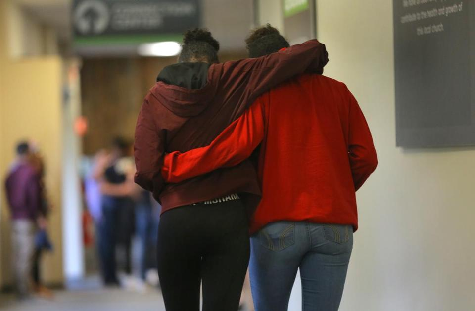 Two girls embraced after a prayer service was held at Grace Church in Avon for the teens involved in a fatal East Bridgewater car crash.