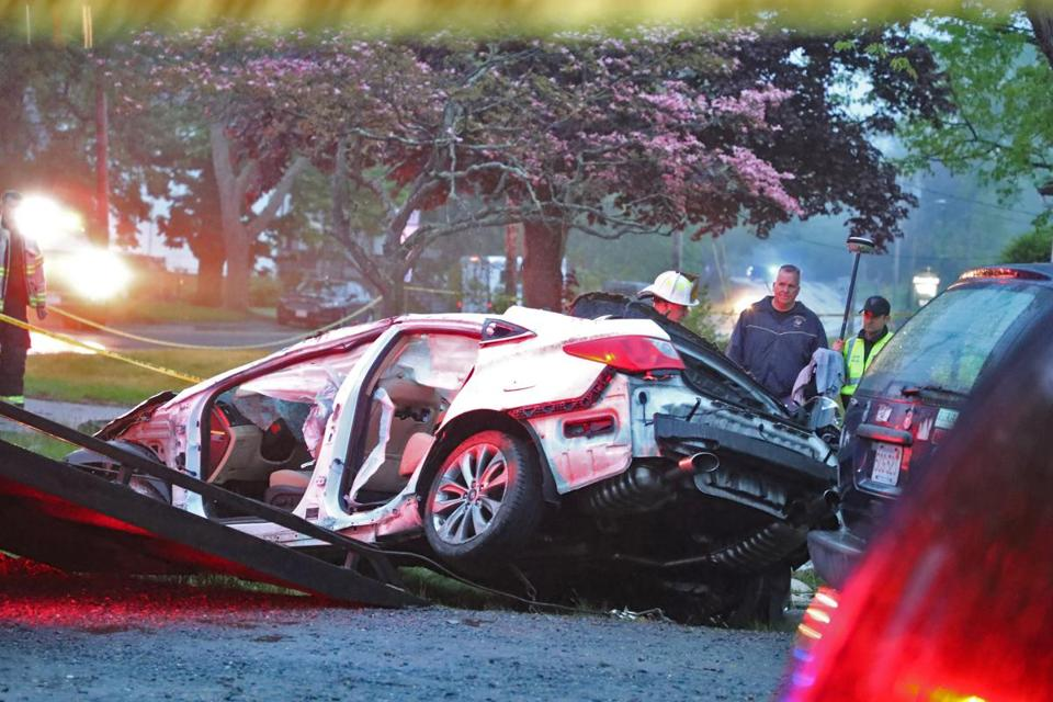 A tow truck removed the wrecked car from the scene of the fatal East Bridgewater crash.