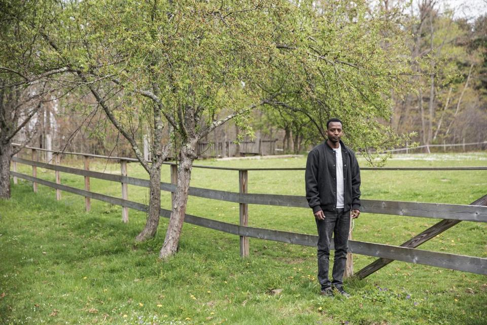 Abdi in front of the  barn at the McDonnell-Parrish home.