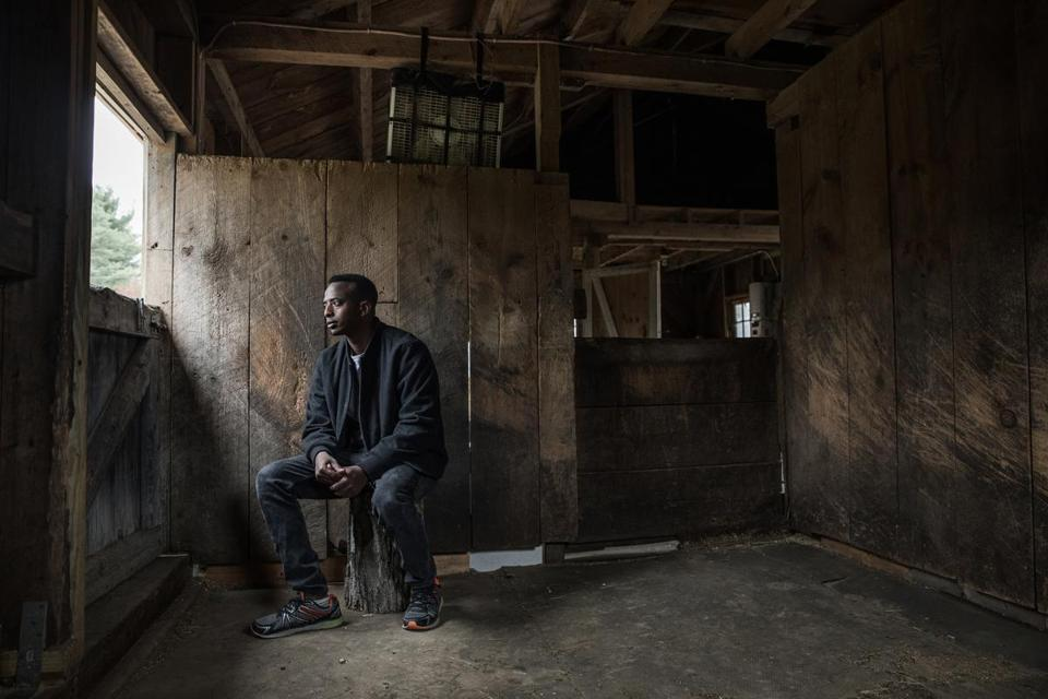 Abdi Nor Iftin in the Maine barn where he cared for horses and chopped wood.