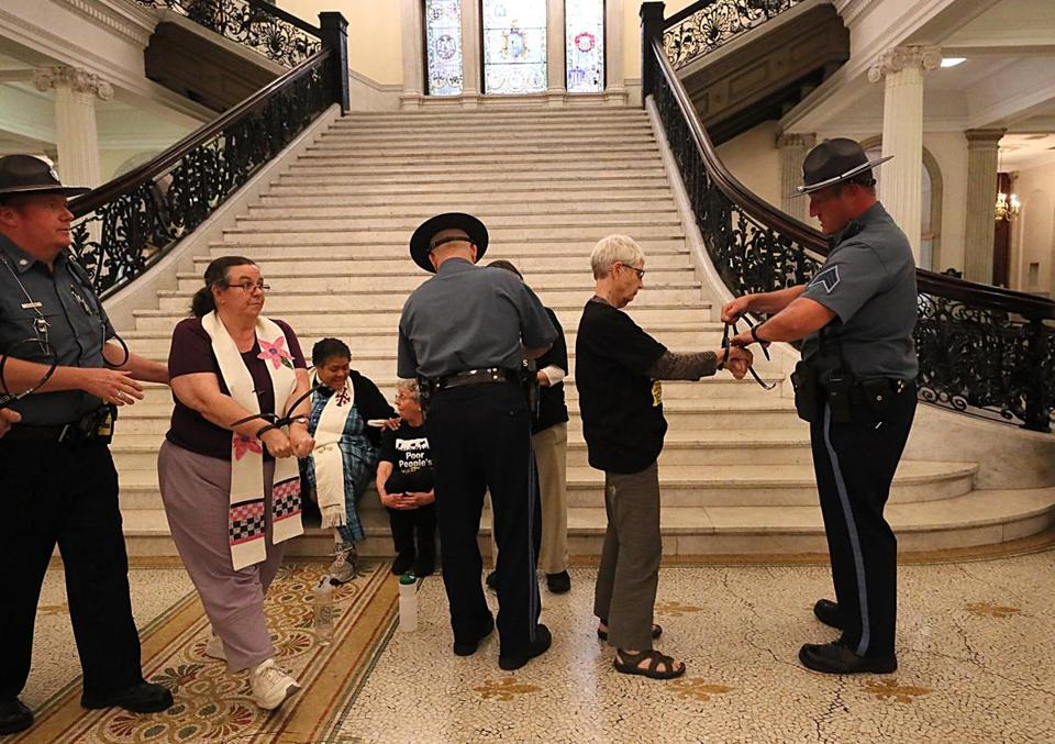 Boston, MA. 05/21/18, The Poor People's Campaign commenced a six week season of actions by marching to the Massachusetts State House, holding a rally, and finally approximately 16 protestors got arrested inside the state house. They were protesting racism. Suzanne Kreiter/Globe staff
