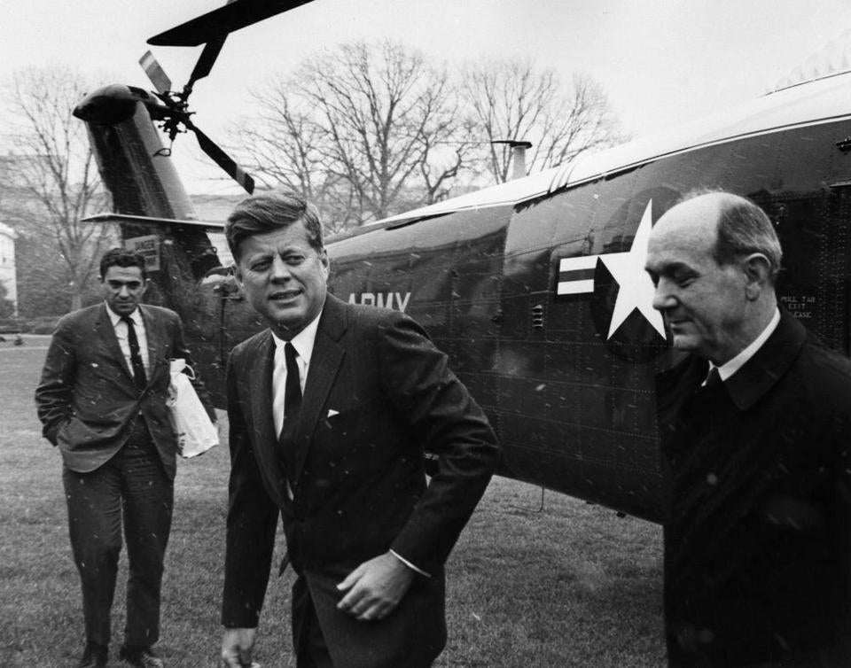 President Kennedy, with Mr. Goodwin (left), greeted Secretary of State Dean Rusk on the White House lawn as Rusk returned from a 1962 conference in Uruguay.