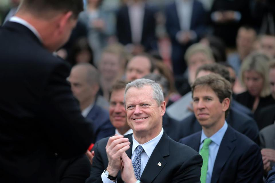 Boston, MA - 05/22/18 - Governor Charlie Baker applauds Mayor Marty Walsh after Walsh spoke at the gathering. Omni Hotels officials, Mayor Walsh, Gov. Baker, and other dignitaries met to pretend to break ground on the Omni hotel project across the street from the convention center in the Seaport District. (Lane Turner/Globe Staff) Reporter: (Jon Chesto) Topic: (23omni)