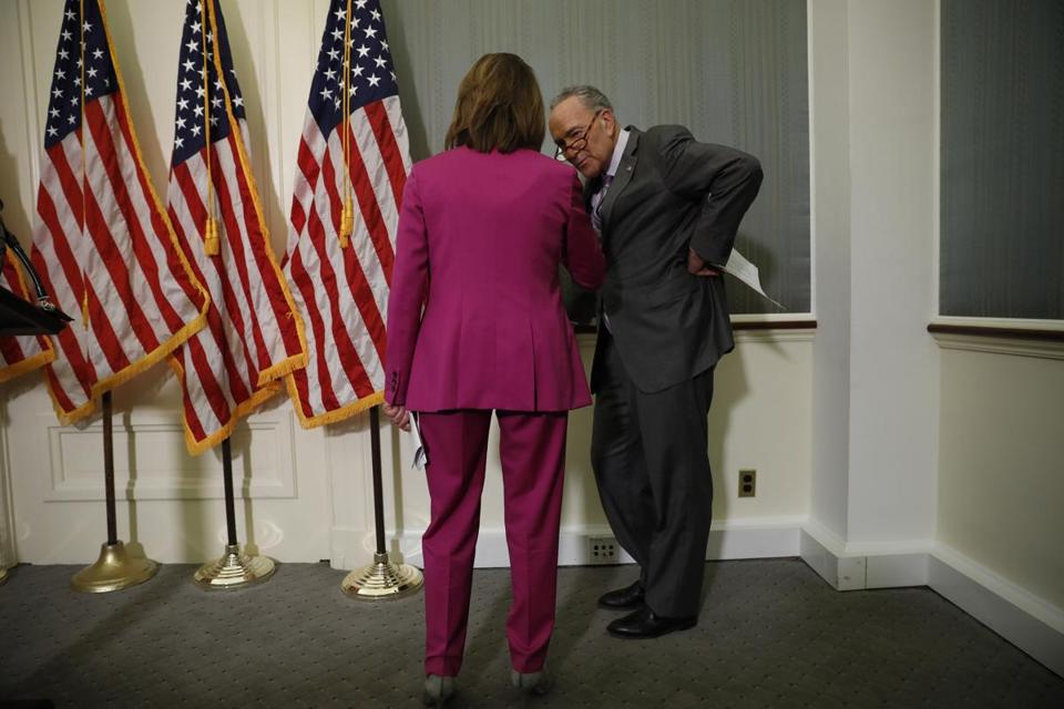 Senate Minority Leader Chuck Schumer spoke to House Minority Leader Nancy Pelosi during a news conference at the Capitol earlier this month.