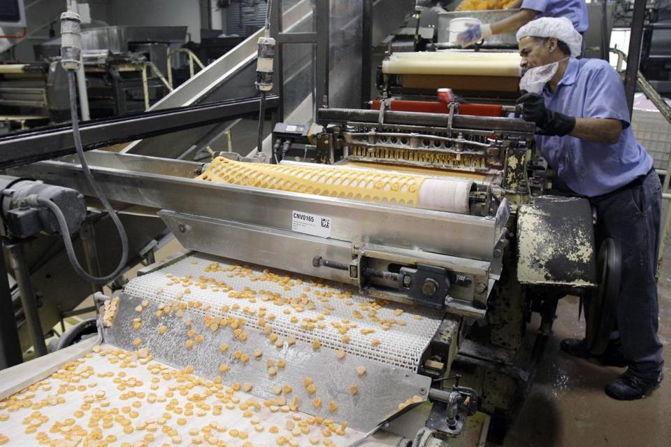 Sweethearts candies drop onto a conveyor belt at the Necco plant in Revere.