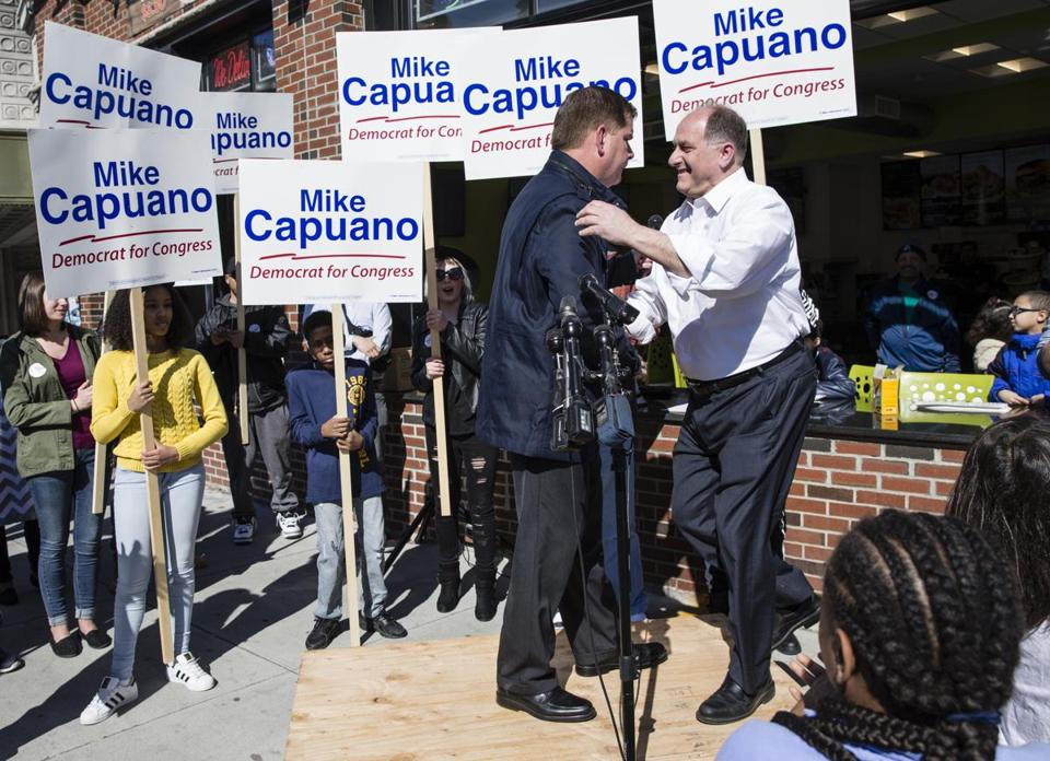 Representative Mike Capuano greeted Boston Mayor Martin J. Walsh on April 22 after Walsh endorsed him for reelection.