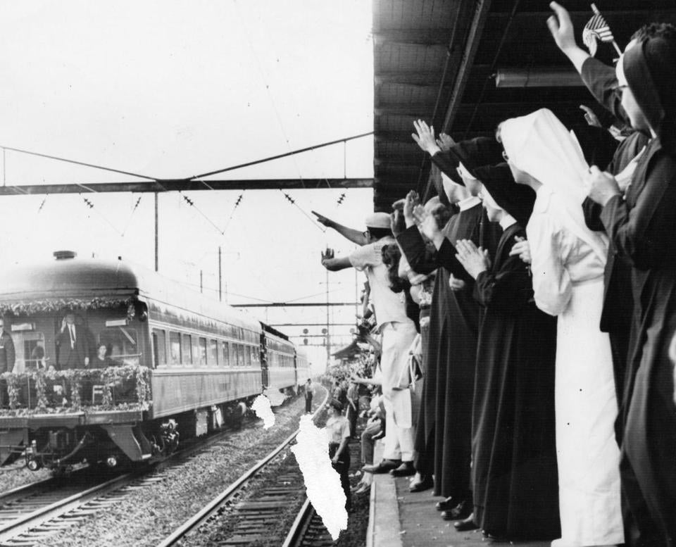 Nuns waved as the train bearing Kennedy's body passed through North Philadelphia on June 8, 1968.