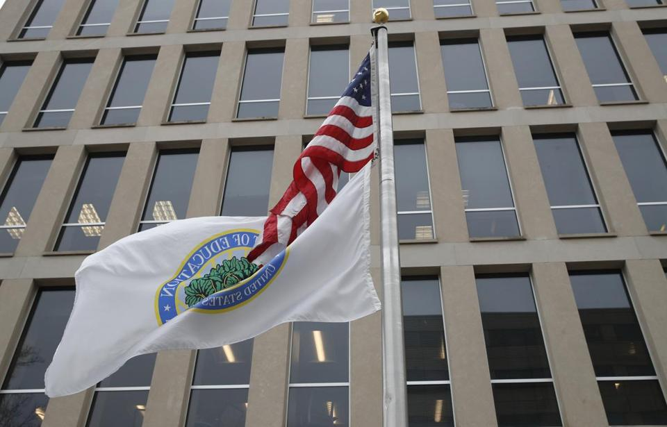 The flag of the Department of Education flies correctly at the Education Department, Tuesday, April 3, 2018, in Washington. (AP Photo/Alex Brandon)