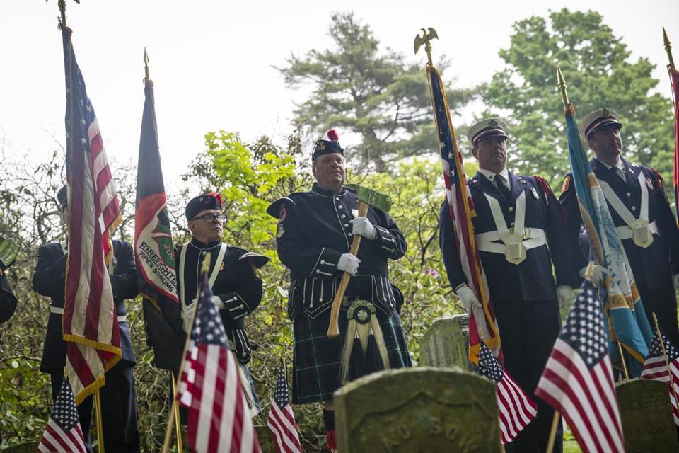 Members of the Boston Fire Department's Pipes and Drums band took part in a ceremony at Cedar Grove Cemetery.