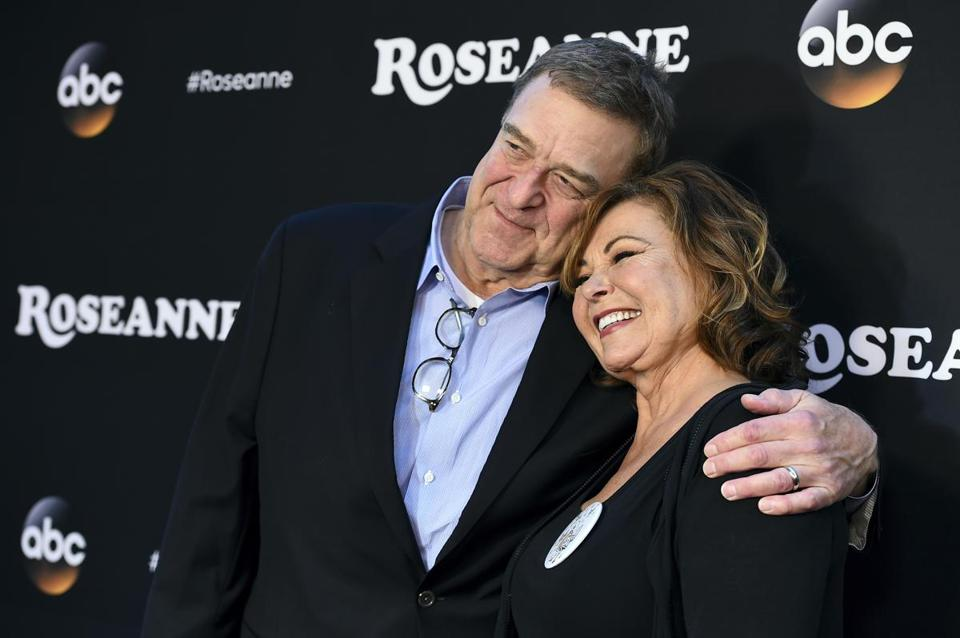"Roseanne Barr with her ""Roseanne"" costar, John Goodman, in March."