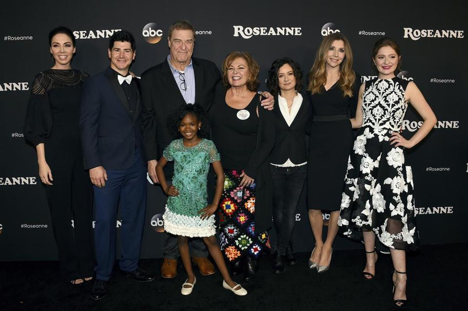 "From left, Whitney Cummings, Michael Fishman, John Goodman, Jayden Rey, Roseanne Barr, Sara Gilbert, Sarah Chalke and Emma Kenney arrive at the Los Angeles premiere of ""Roseanne"" in Burbank, Calif in March."
