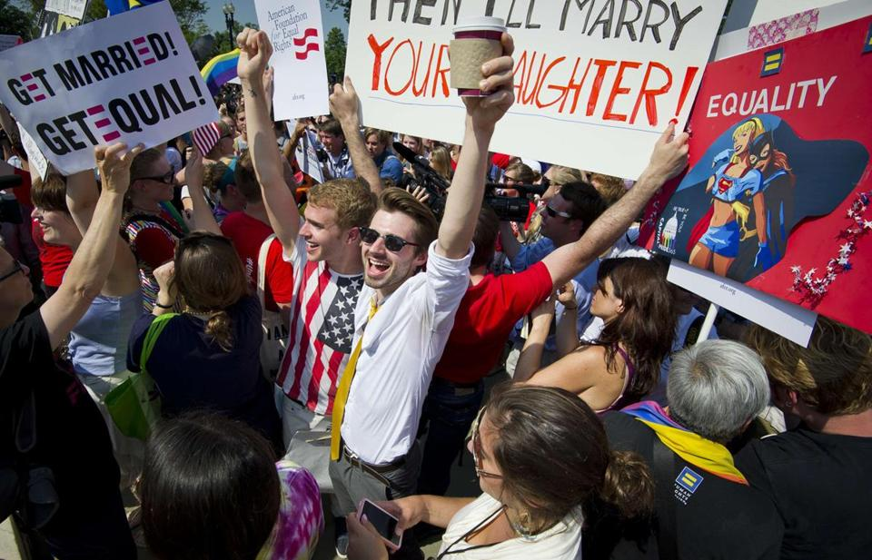 Gay rights activists reacted outside the US Supreme Court building in Washington, D.C., on June 26, 2013.