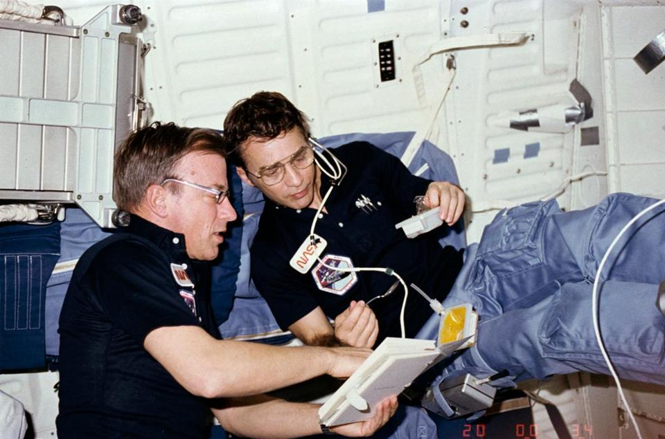 Donald H. Peterson, right, aboard the space shuttle Challenger with fellow astronaut Paul J. Weitz. MUST CREDIT: Handout from NASA