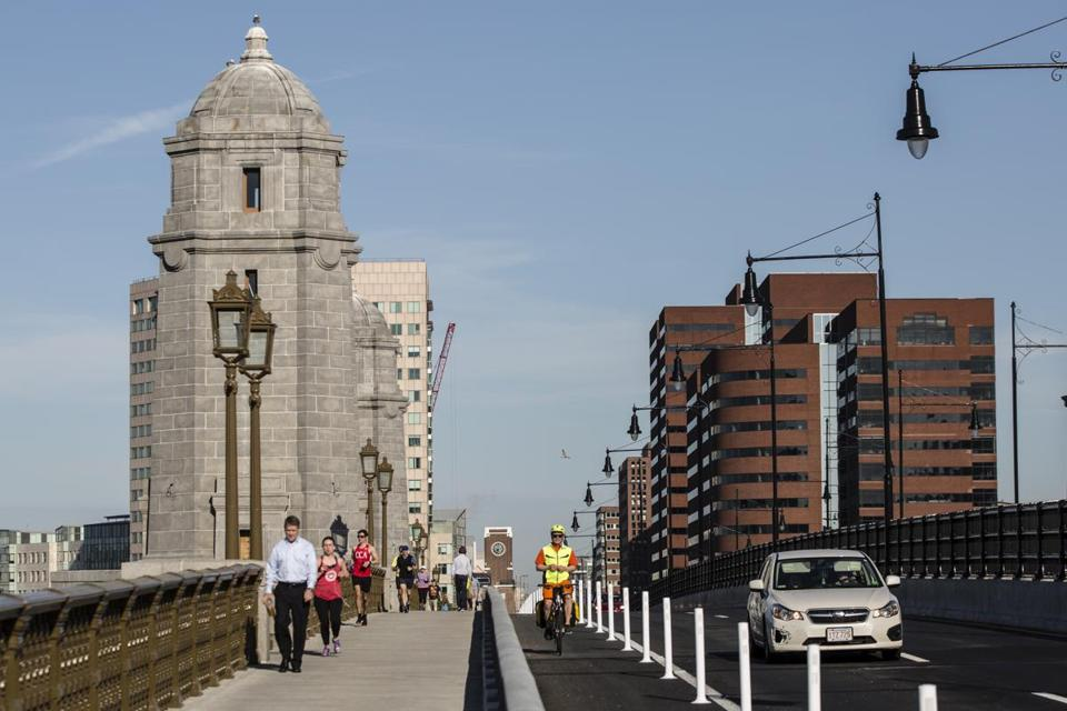 Pedestrians, cyclists and automobile traffic moved along the Longfellow Bridge on Thursday.