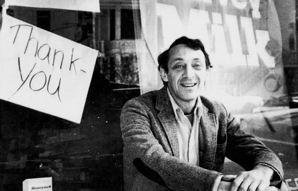 Harvey Milk sits outside his camera shop in San Francisco shortly after his election in 1977.