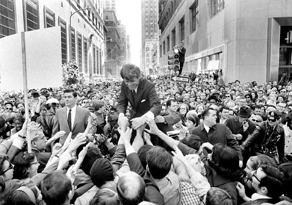 Senator Robert F. Kennedy, surrounded by an enthusiastic crowd, campaigned in Philadelphia in April 1968.