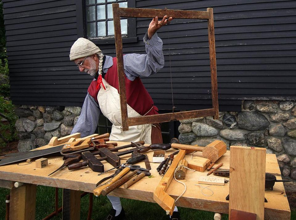 Salem, MA - 6/02/2018 - Mike Welch, a woodworker and historical reenactor from West Newbury gives a demonstration of colonial carpentry. The House of Seven Gables is celebrating its 350th anniversary. - (Barry Chin/Globe Staff), Section: Regional/All Zones, Reporter: James Sullivan, Topic: 24zogables, LOID: 8.4.2123146174.