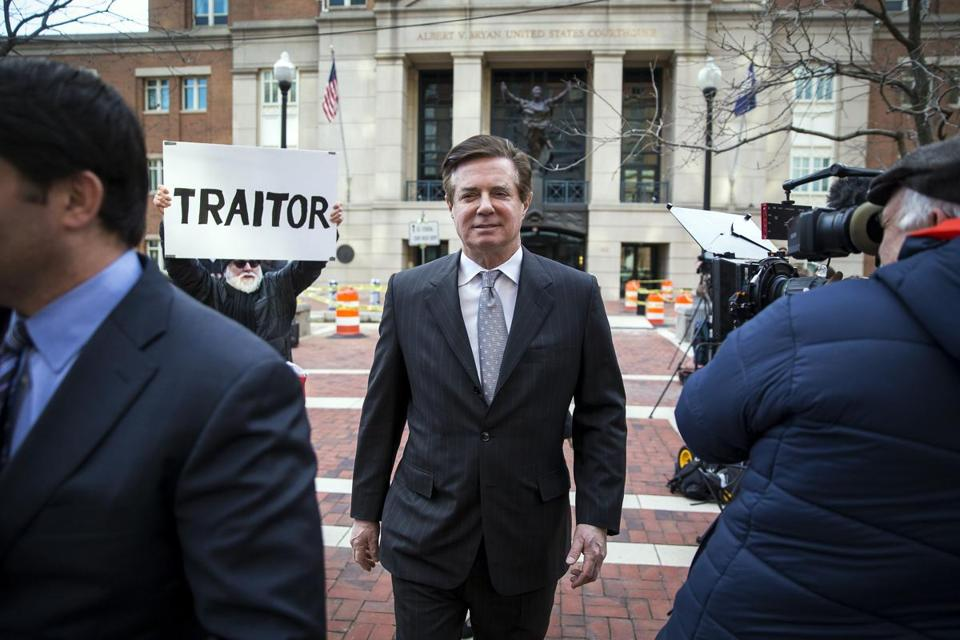 The special counsel's office says Paul Manafort (above) and one of his associates ''repeatedly'' contacted two witnesses in an effort to influence their testimony.