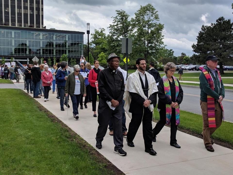 Protesters marched silently on Tuesday in front of the ICE offices in Burlington.