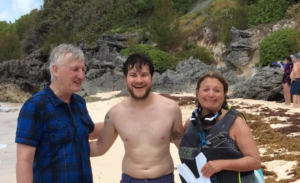 Paul and Anita Trenholm pose with Allen Yannone, of Medfield (center), in Bermuda after he rescued the couple from the water, where they had become stranded.