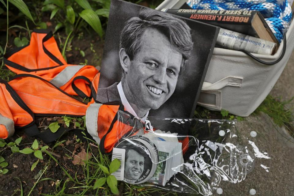 Memorabilia of Robert F. Kennedy rested on the ground at the family home in Brookline where brother John F. Kennedy was born; it was where Wednesday's march began.