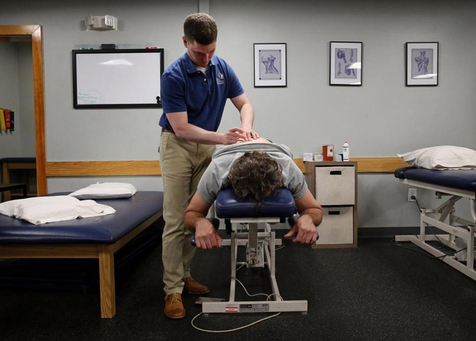 Beverly physical therapist Andy McLlarky performed a dry needling treatment on a patient with back and hip pain.