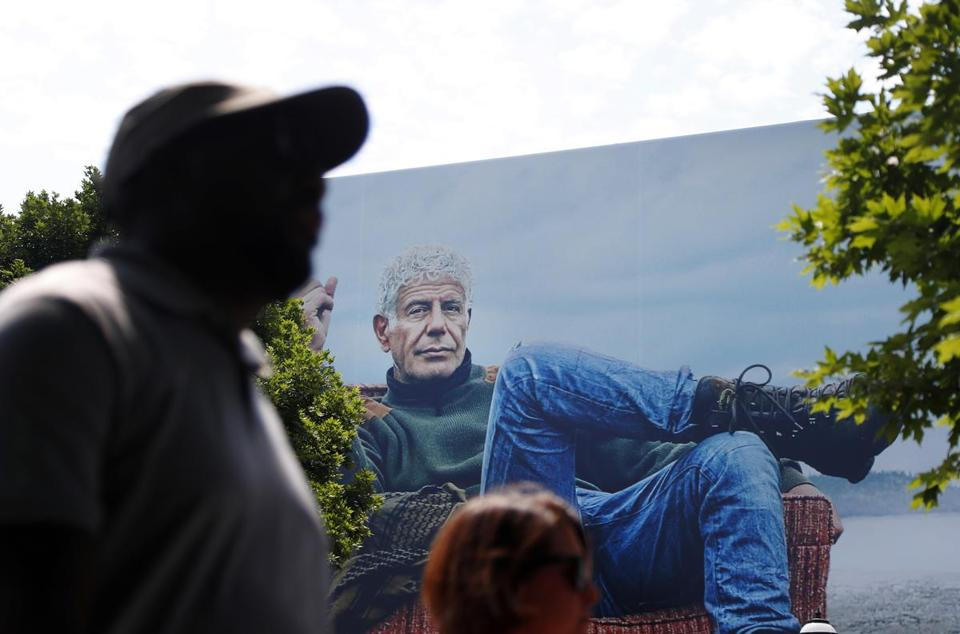 "People walk past a billboard for the CNN television show ""Parts Unknown"" with American celebrity chef Anthony Bourdain, Friday, June 8, 2018 in Atlanta. Bourdain, 61, was found dead Friday in his hotel room in France while working on the series which features culinary traditions around the world."