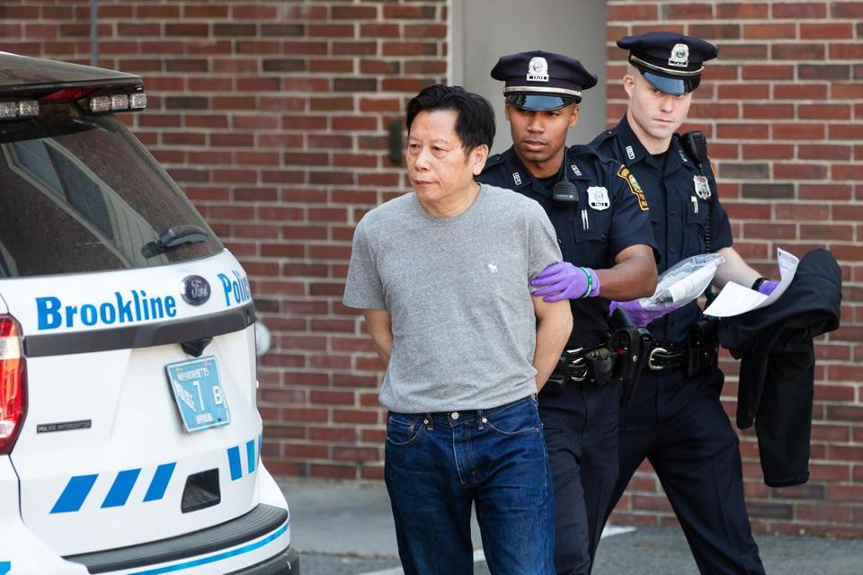 Tze Ping Chung was led into Brookline District Court Friday.