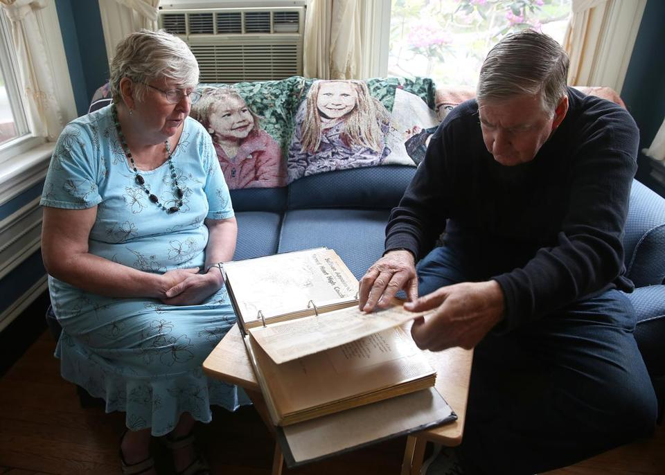 Eleanor Sullivan Donato and Tom Sullivan flipped through a photo album and scrap book while they talked about their brother, Paul J. Sullivan, who was killed in Vietnam 50 years ago. The family will award the 50th scholarship in his memory.