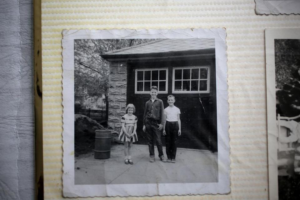 A circa 1956 photograph of, from left, Eleanor, Paul, and Tom, is kept in the family's scrap book and photo album.