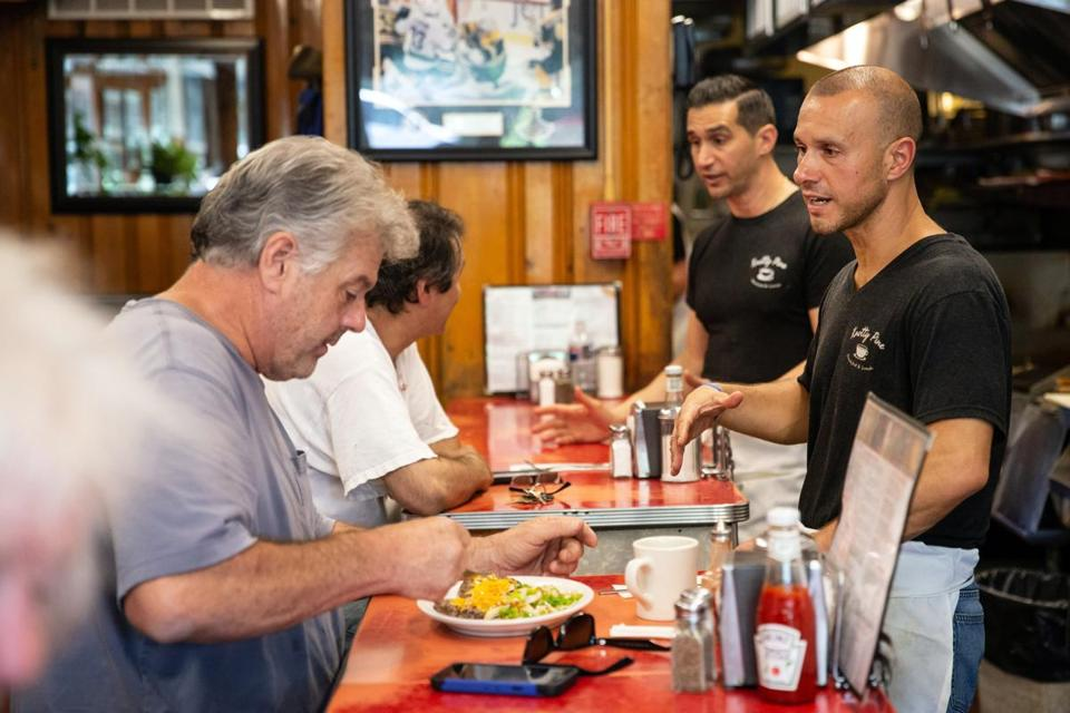 06/08/2018 AUBURNDALE, MA Brothers and co-owners Nick Kourtis (cq) (center) and Bill Kourtis (cq) (right) speak with customers at Knotty Pine in Auburndale. (Aram Boghosian for The Boston Globe)