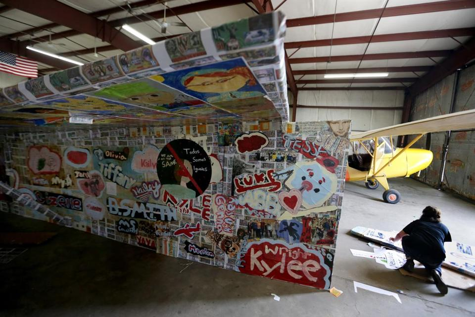 Coraly Rivera-Beck helped to construct 64-foot paper airplane as part of Project Soar. The project has enlisted more than 5,000 artists, young people, engineers, business and civic leaders, and citizens to be part of the project.