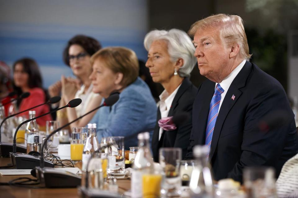 President Trump listened Saturday during a session at the G-7 summit. Trump's Twitter comments after the summit threatened to escalate an ongoing trade war.