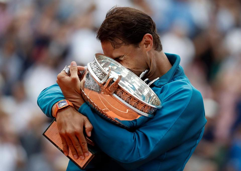 Mandatory Credit: Photo by CHRISTOPHE PETIT TESSON/EPA-EFE/REX/Shutterstock (9708970hs) Rafael Nadal of Spain celebrates with the trophy after winning his 11th French Open title against Dominic Thiem of Austria during their men?s final match during the French Open tennis tournament at Roland Garros in Paris, France, 10 June 2018. French Open tennis tournament at Roland Garros, Paris, France - 10 Jun 2018