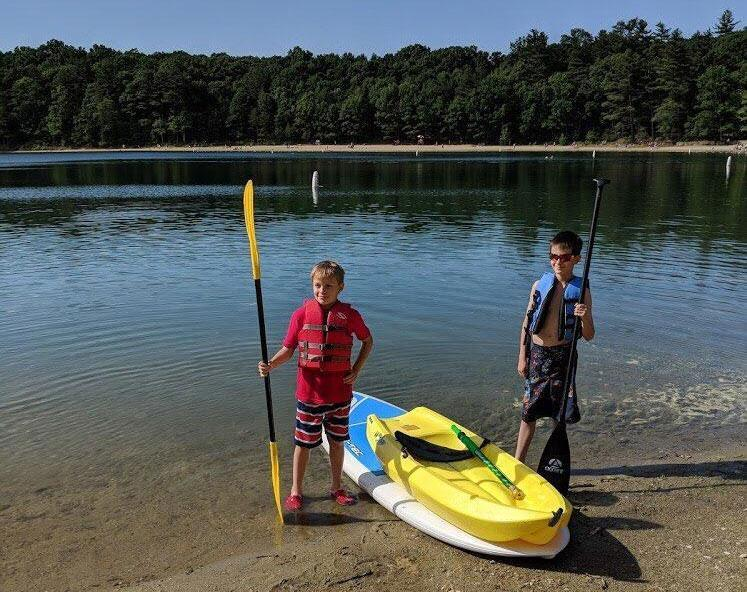 Herman Tsakhaev, 9, of Sudbury, and Bodie Thompson, 11, of Lincoln, were kayaking and paddle boarding on Walden Pond Sunday when they saw an adult struggling in the water.