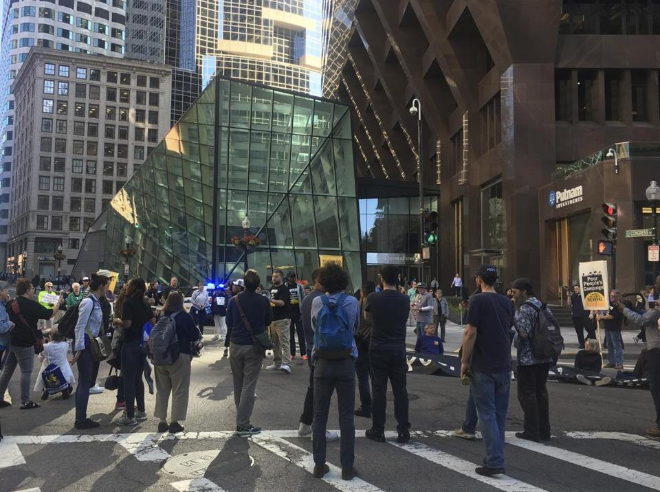 Protesters from the Massachusetts Poor People's Campaign marched from the State House to Post Office Square, where they shut down traffic in the heart of the financial district.