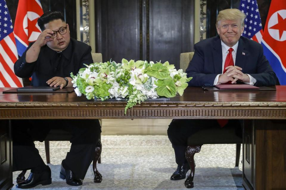 President Donald Trump smiled after signing documents with North Korea leader Kim Jong Un.