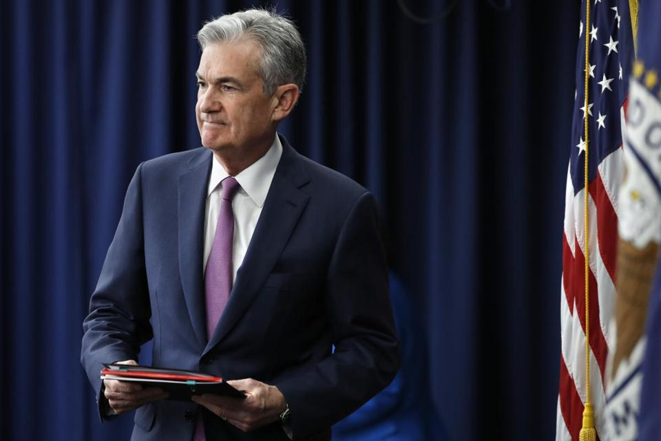 Federal Reserve Chair Jerome Powell arrives to a news conference after the Federal Open Market Committee meeting, Wednesday, June 13, 2018, in Washington. The Federal Reserve took note of a resilient U.S. economy Wednesday by raising its benchmark interest rate for the second time this year and signaling that it may step up its pace of rate increases. The Fed now foresees four rate hikes this year, up from the three it had previously forecast. (AP Photo/Jacquelyn Martin)