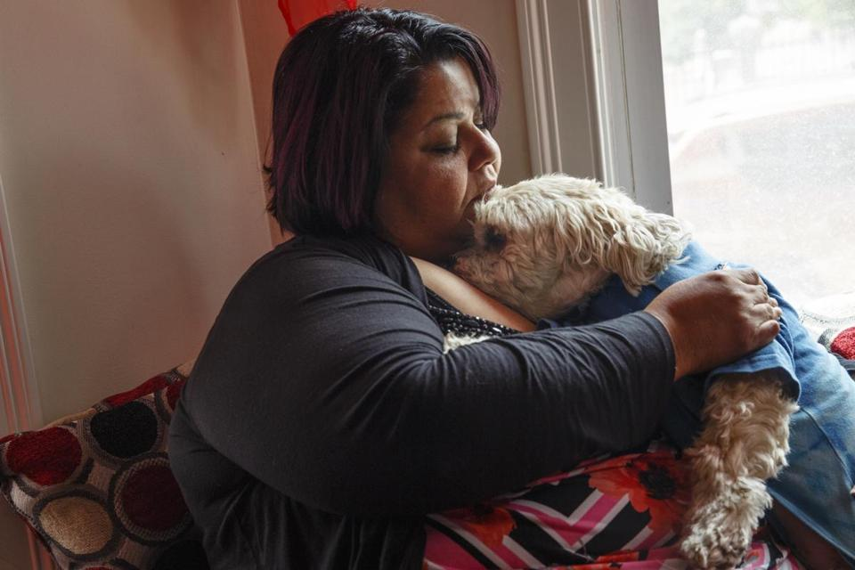 Amarilys Martinez held her dog Nikko in Nashua, N.H., on Wednesday after they were reunited.