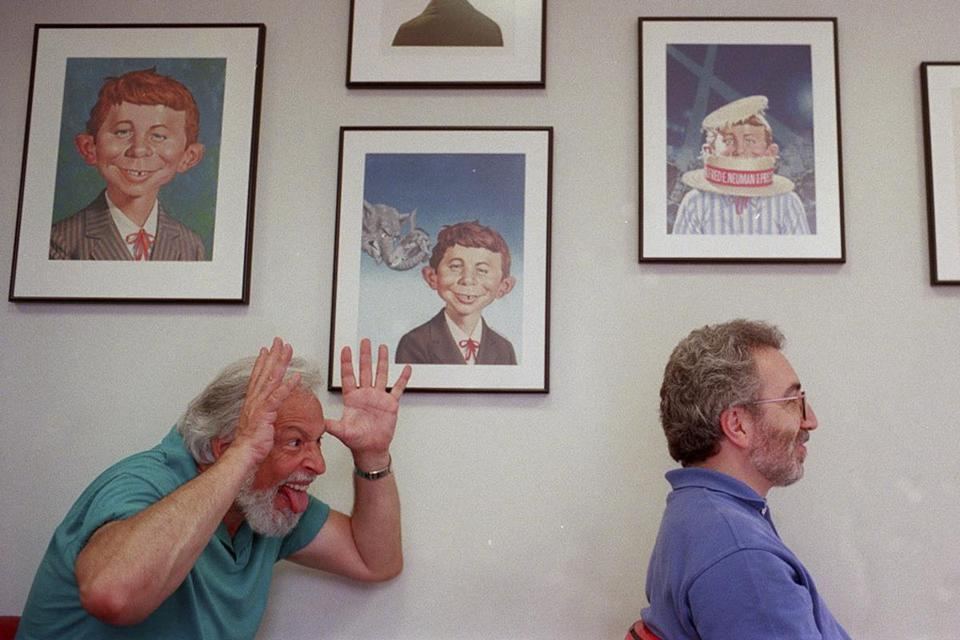 FILE — Nick Meglin, left, and John Ficarra, the editors of Mad Magazine, in New York, June 25, 1997. Meglin, who for many years was the chief barometer of whether the publication's silly and satirical humor had gone too far — or not far enough — died at home in Durham, N.C. on June 2, 2018. He was 82. (Edward Keating/The New York Times)